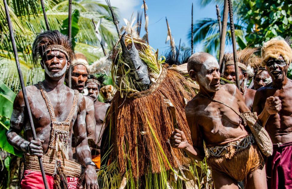 Ancestors, embodied by spirit masks touring the village . Youw Village, Atsy District, Asmat. New Guinea.